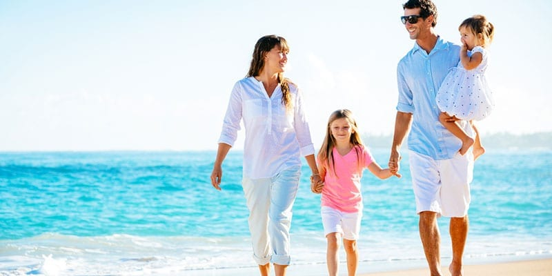family-beach-shutterstock_178520768